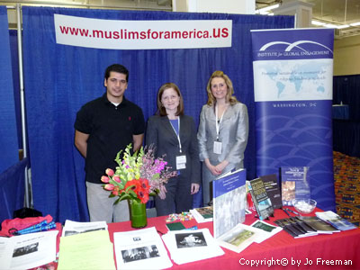 Muslims For America at a cluttered table